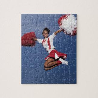 Cheerleader in mid-air jigsaw puzzle