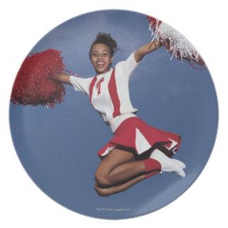 Cheerleader in mid-air dinner plate
