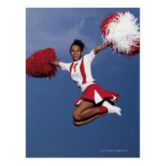 Cheerleader in mid-air postcard