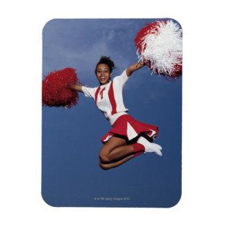 Cheerleader in mid-air rectangular photo magnet