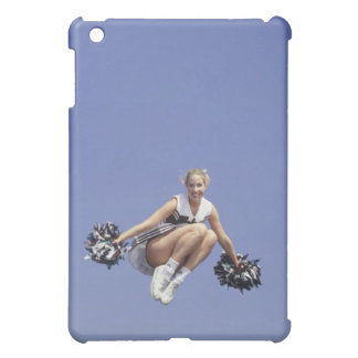 Cheerleader jumping, low angle view, portrait iPad mini cover
