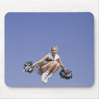 Cheerleader jumping, low angle view, portrait mouse pad