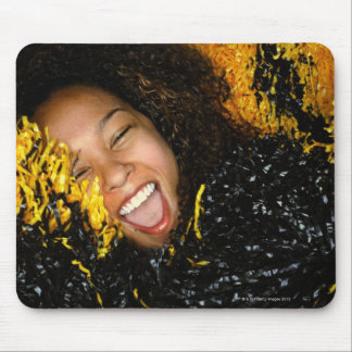 Cheerleader laughing, surrounded by pompoms, mouse pad