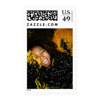 Cheerleader laughing, surrounded by pompoms, postage