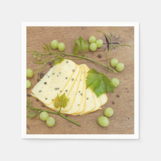 cheese in slices with grapes paper napkin