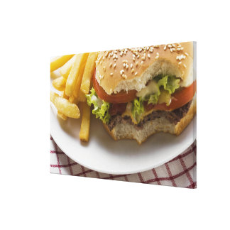 Cheeseburger, bites taken, with chips canvas print