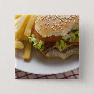 Cheeseburger, bites taken, with chips pinback button