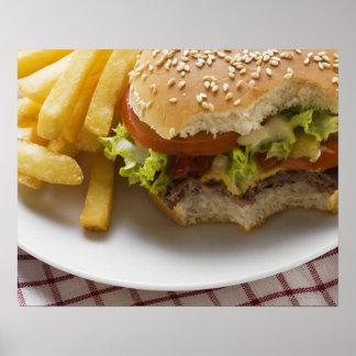 Cheeseburger, bites taken, with chips poster