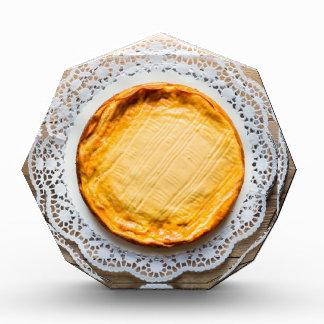 Cheesecake on rustic wood cake top. award