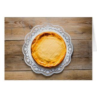 Cheesecake on rustic wood cake top. card