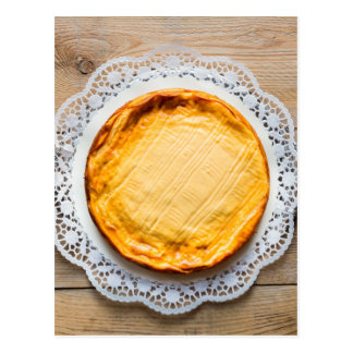Cheesecake on rustic wood cake top. postcard