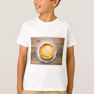 Cheesecake on rustic wood cake top. T-Shirt
