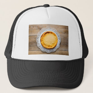 Cheesecake on rustic wood cake top. trucker hat