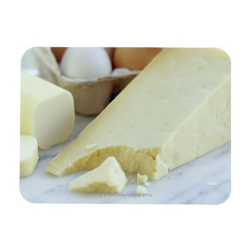 Cheeses and eggs. Eggs are rich in protein and Rectangular Magnets