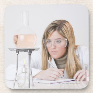 Chemist looking at Bunsen burner Beverage Coaster
