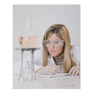 Chemist looking at Bunsen burner Poster