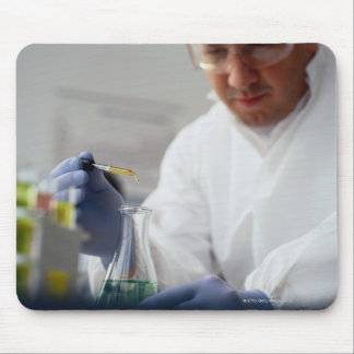 Chemist Measuring Drops into a Flask Mouse Pad