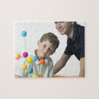 Chemistry lesson. 6 year old boy and his teacher jigsaw puzzle