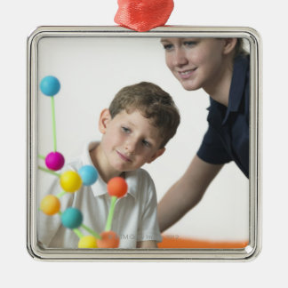 Chemistry lesson. 6 year old boy and his teacher metal ornament
