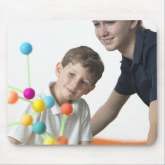 Chemistry lesson. 6 year old boy and his teacher mouse pad