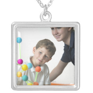 Chemistry lesson. 6 year old boy and his teacher silver plated necklace