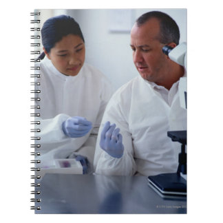 Chemists Looking at a Glass Slide Together Spiral Notebook