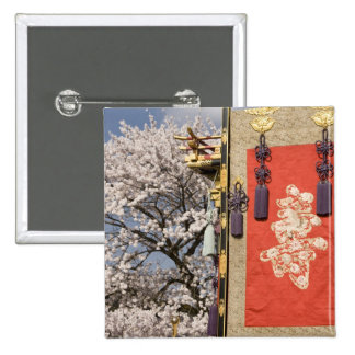 Cherry blossom tree and silk tapestry of pinback buttons
