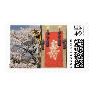 Cherry blossom tree and silk tapestry of postage stamp