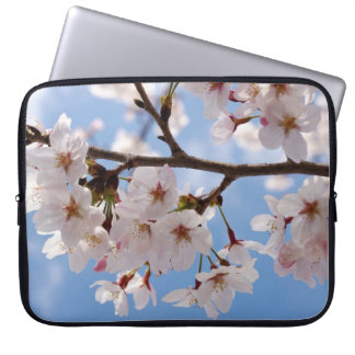 Cherry blossoms and light-blue sky computer sleeve