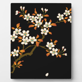 Cherry blossoms bloom and shine at night display plaques
