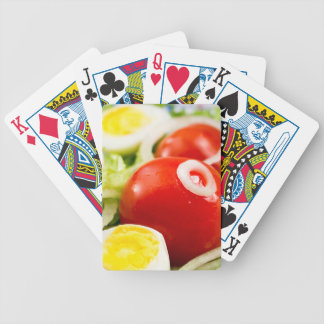 Cherry tomatoes and boiled eggs in a salad bicycle playing cards
