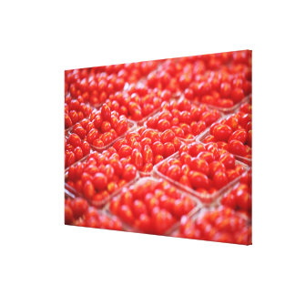 Cherry tomatoes at a market stall canvas print
