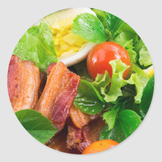 Cherry tomatoes, herbs, olive oil, eggs and bacon classic round sticker