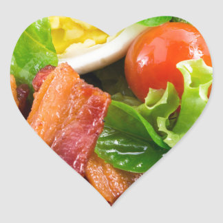 Cherry tomatoes, herbs, olive oil, eggs and bacon heart sticker