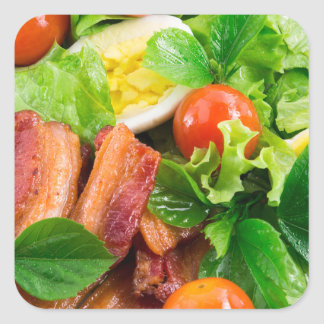 Cherry tomatoes, herbs, olive oil, eggs and bacon square sticker