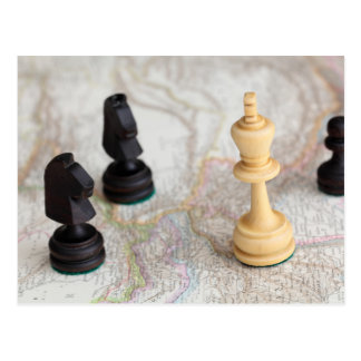 Chess figures on a map postcard