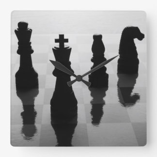 Chess pieces on chess board in black and white square wall clock