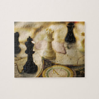 Chess pieces on old world map jigsaw puzzle