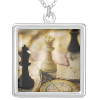 Chess pieces on old world map silver plated necklace