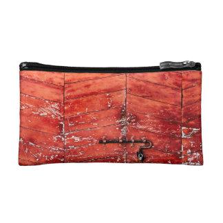 Chevron pattern effect on vintage red door cosmetic bags
