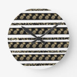 Chic black and gold confetti pineapple stripes round clock