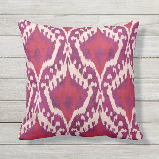 Chic colorful red and purple ikat tribal patterns outdoor pillow