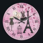 "Chic Girly Pink Paris Fashion Clock<br><div class=""desc"">Whimsical, romantic, classy pink Paris roman numerals clock with the Eiffel Tower, French magazines, beautiful pink and black corset, dressmaker&#39;s mannequin, antique bird cage and hearts on a shabby chic pink vintage look background. An elegant, fun, trendy, glamorous gift for women and teenage girls. Some elements purchased from Suz Brill...</div>"
