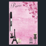 "Chic Girly Pink Paris Fashion Dry Erase Board<br><div class=""desc"">Whimsical, romantic, classy pink Paris dry erase board with the Eiffel Tower, French magazines, beautiful pink and black corset, dressmaker&#39;s mannequin, antique bird cage and hearts on a shabby chic pink vintage look background. An elegant, fun, trendy, glamorous gift for women and teenage girls. Some elements purchased from Suz Brill...</div>"