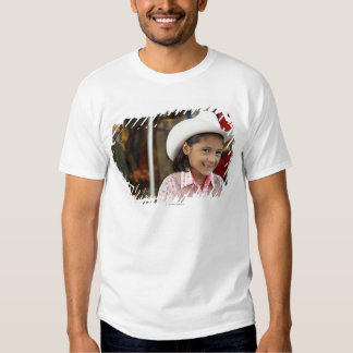 Chica (8-10) stetson que lleva, sonriendo camisas
