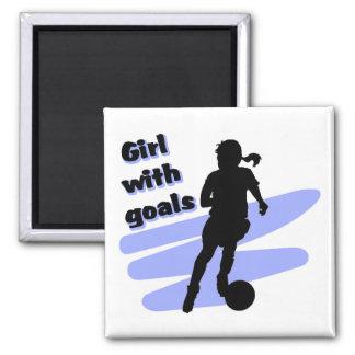 Chica con el imán de las metas