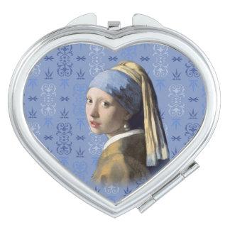 Chica con el pendiente de la perla espejos compactos