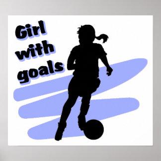 Chica con el poster de las metas