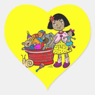 Chica con la cesta de juguetes pegatina corazón personalizadas