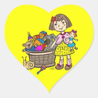 Chica con la cesta de juguetes colcomanias de corazon